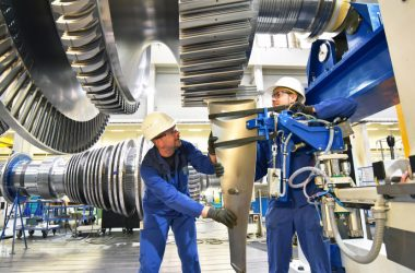 Image representing two industrial operaters working in the manufacturing sector.