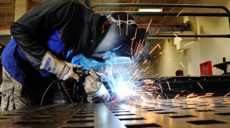 Image Showing A Welder Welding An Iron - Representing Tools & Equipments Usage Of Stainless STeel Fabricating Company.